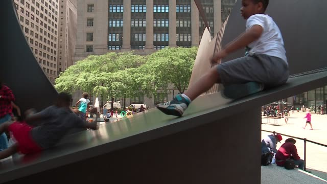 wgn children climb and slide on chicago's picasso sculpture at daley plaza on aug 8 2017 - cubism stock videos & royalty-free footage
