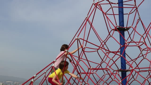 children climbing on play equipment - jungle gym stock videos and b-roll footage