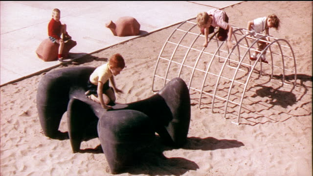 1958 MONTAGE WS MS Children climbing on playground equipment, pair of monkeys playing in their cage / USA / AUDIO