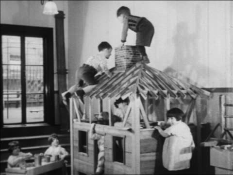 b/w 1934 children climbing playhouse in nursery school / wpa project / newsreel - playhouse stock videos and b-roll footage