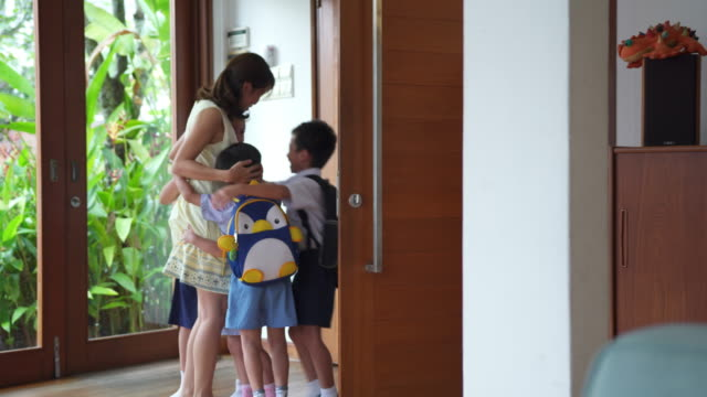 children coming home and embracing their mother - arrival stock videos & royalty-free footage