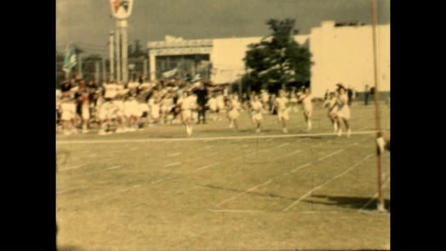 Children compete in an athletics competition at King Edward VII School during the 1960's