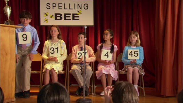 Children competing in spelling bee / Los Angeles, California