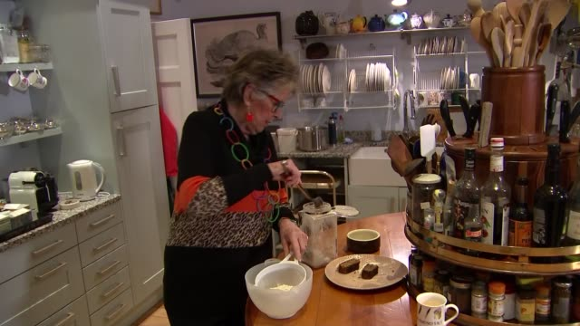 prue leith setups in kitchen england int prue leith setup shots sifting flour in kitchen - prudence leith stock videos and b-roll footage