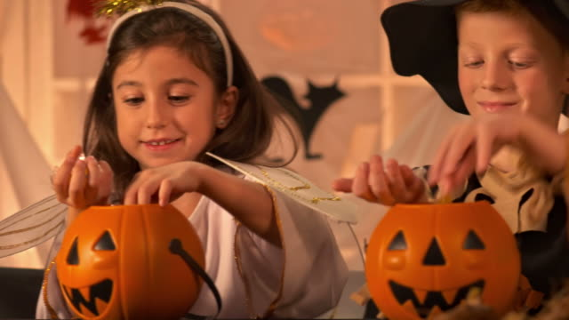 hd dolly: children counting halloween candies - confectionery stock videos & royalty-free footage