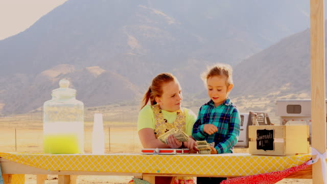 children counting money at a rural lemonade stand - selling stock videos & royalty-free footage