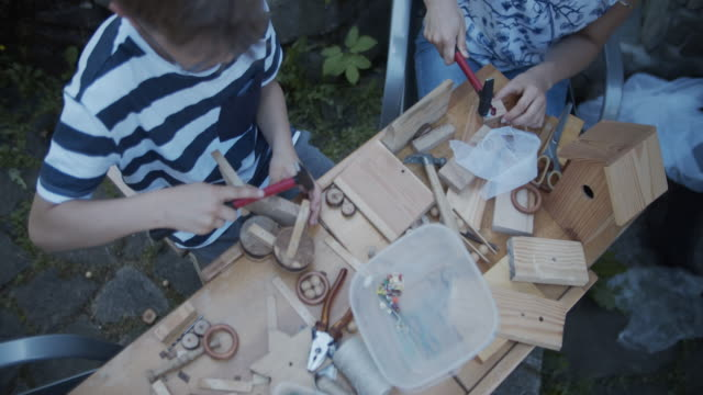 children crafting fun stuff using pieces wood - table top view stock videos & royalty-free footage