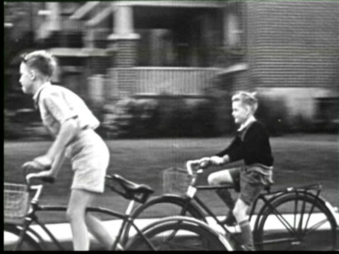 b/w pov  children cycling on city street, ottawa, canada / audio - モノクロ点の映像素材/bロール