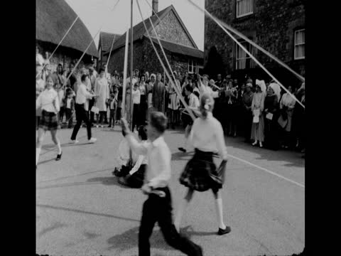 children dancing around a maypole at a fair in chardstock, devon; 1971 - tradition stock videos & royalty-free footage