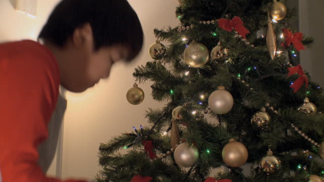 ms children (2-9) decorating christmas tree / tokyo, japan   - christianity stock videos & royalty-free footage