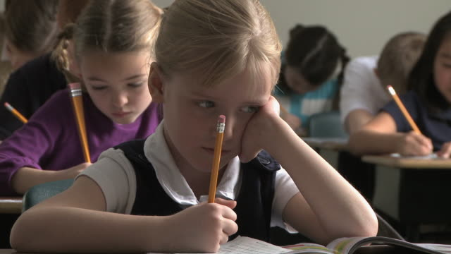 children doing schoolwork - see other clips from this shoot 1148 stock videos and b-roll footage
