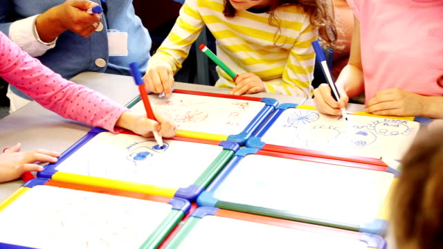 children drawing in class - teacher stock videos & royalty-free footage