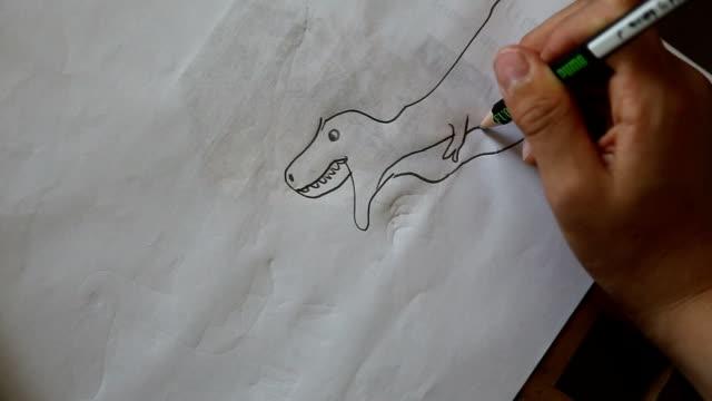 children drawings dinosaur, close up at hand hd. - crayon stock videos & royalty-free footage