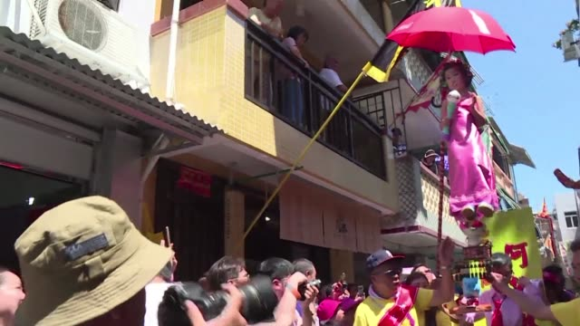children dressed as ancient gods celebrities and political leaders are paraded high above crowds on the hong kong island of cheung chau in a... - buddha's birthday stock videos and b-roll footage