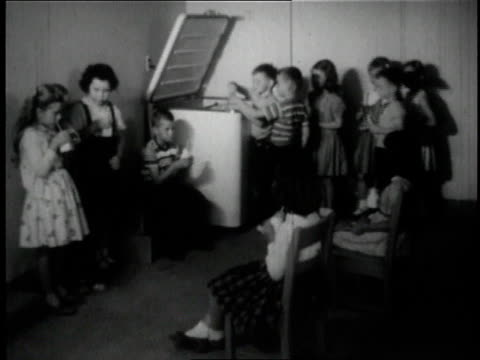 1950 montage children drinking milk in converted garage / wayne, ohio, united states - cool box stock videos & royalty-free footage
