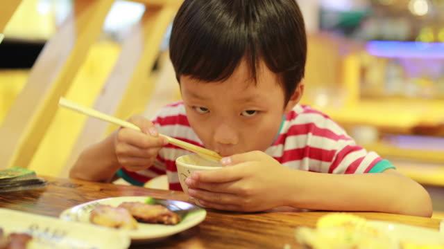 children eat lunch - chopsticks stock videos & royalty-free footage