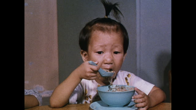 MONTAGE Children eating a meal in a lunchroom in Hong Kong