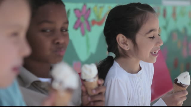 CU Children eating ice cream cones / Los Angeles, California, United States