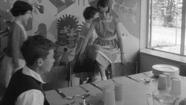 1960 montage children eating lunch at school / united kingdom - eating utensil stock videos & royalty-free footage