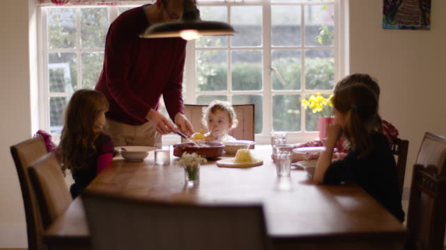 children eating lunch - cucina domestica video stock e b–roll