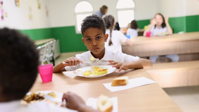 children eating school dinners - school dinner stock videos & royalty-free footage