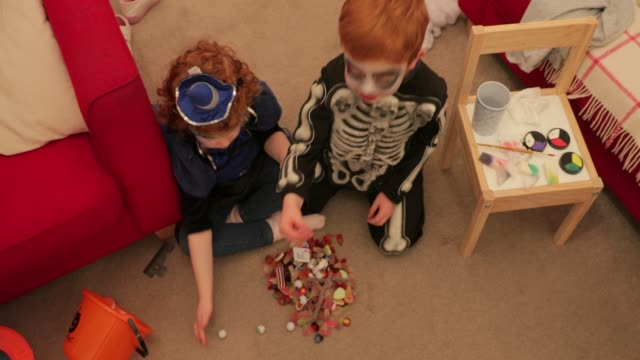 children eating sweets on halloween! - stage costume stock videos & royalty-free footage