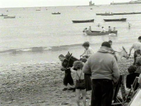 children enjoy donkey rides on the beach at douglas isle of man 1954 - isle of man stock videos & royalty-free footage