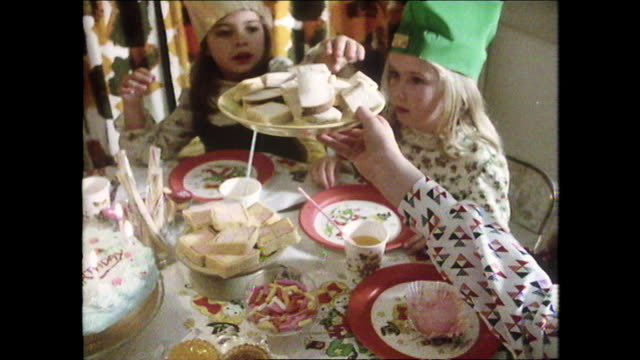 children enjoy tea at birthday party; 1975 - sandwich stock videos & royalty-free footage