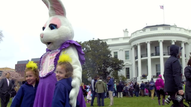 children enjoy the 140th annual easter egg roll on the south lawn of the white house april 2 2018 in washington dc the white house said they are... - b rolle stock-videos und b-roll-filmmaterial