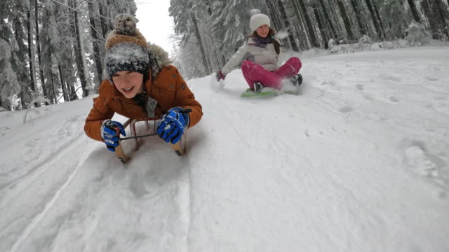 children enjoying sledding in winter forest. - poland stock videos & royalty-free footage