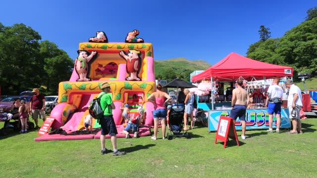 children enjoying the bouncy castle at the annual ambleside sports event, ambleside, lake district, united kingdom. - multi coloured stock videos & royalty-free footage