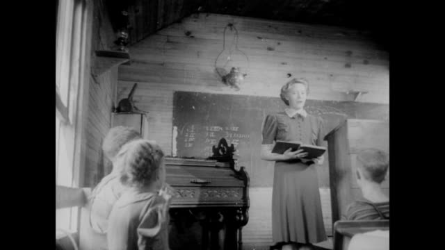 / children enter and find their seats in one room school house in the Tennessee Valley / teacher begins to read / CU children's faces as narrator...