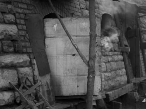 b/w 1935 children exiting door of coke oven at coal mines / pennsylvania / newsreel - 1935 stock videos & royalty-free footage