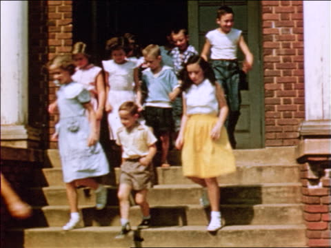 1954 children exiting school door + running down stairs / documentary - caucasian appearance stock videos & royalty-free footage