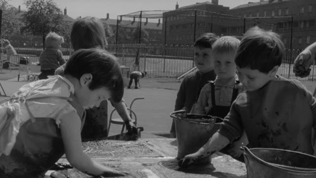 1960 montage children finger painting in nursery school / united kingdom - finger painting stock videos and b-roll footage