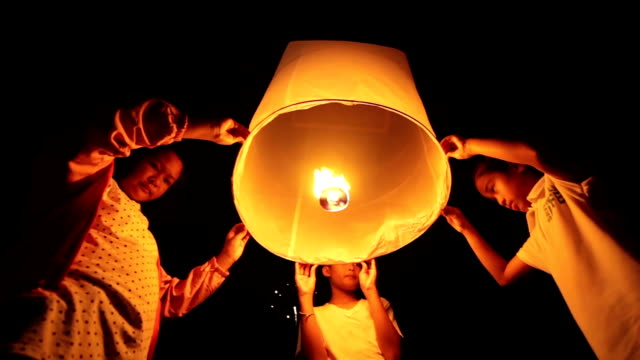 children floating sky lantern - sky lantern stock videos & royalty-free footage