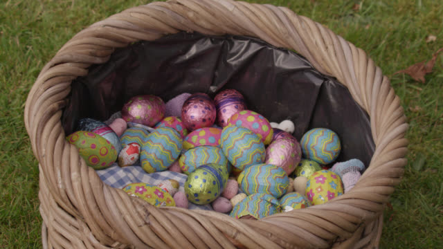 Children gather chocolate during easter egg hunt, Bristol, England