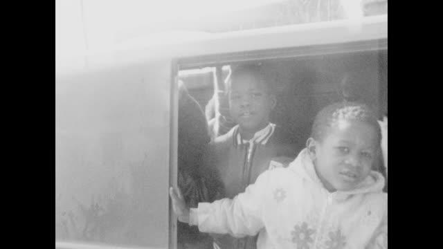 children get in van to be taken home after breakfast. - oakland california stock videos & royalty-free footage