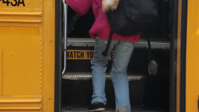 children getting on school bus - bus stock videos & royalty-free footage