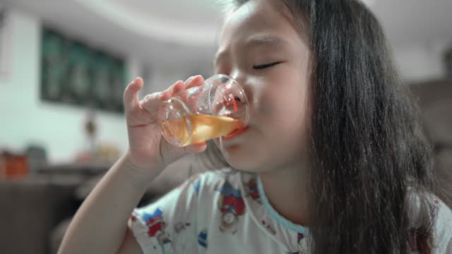 children girl are drinking medicine - two generation family stock videos & royalty-free footage