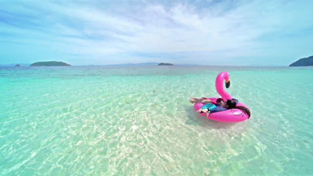 children girl playing on the sea - inflatable stock videos & royalty-free footage