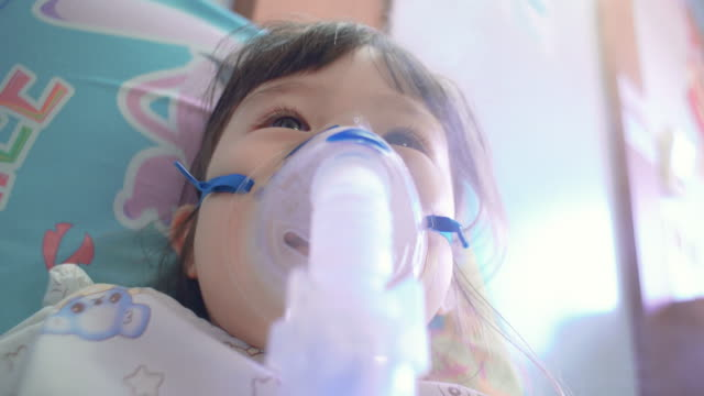children girl with nebulizer mask in hospital - bronchus stock videos & royalty-free footage