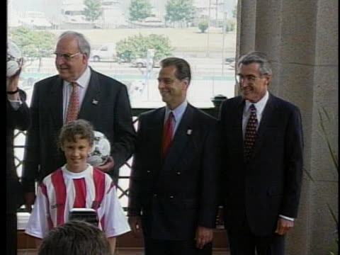 children give united states president bill clinton and others soccer balls in honor of the united states hosting the world cup. - anno 1994 video stock e b–roll