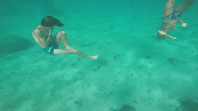 children go underwater - huahine island stock videos and b-roll footage