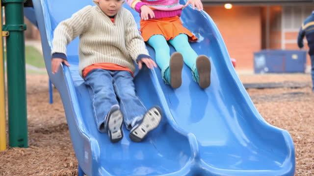 MS TU Children going down on slides on playground / Richmond, Virginia, USA