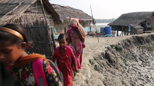 children going to school in coastal area bangladesh will lose a significant part of its territory to the sealevel rise causing mass displacement of... - arid stock videos & royalty-free footage