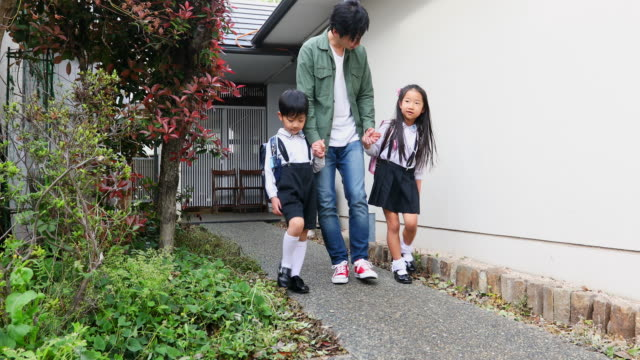 children going to school with their father - japanese school uniform stock videos & royalty-free footage