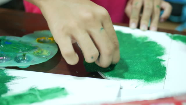 children hand painting on paper - gouache stock videos & royalty-free footage