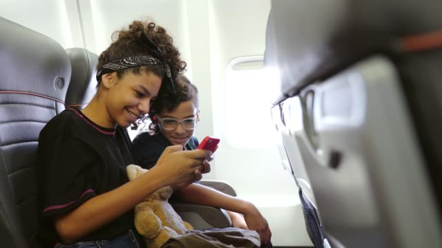 children having fun on the plane - abitacolo video stock e b–roll