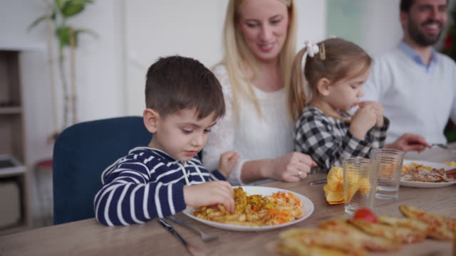 children having lunch with parents together at home - young family stock videos & royalty-free footage
